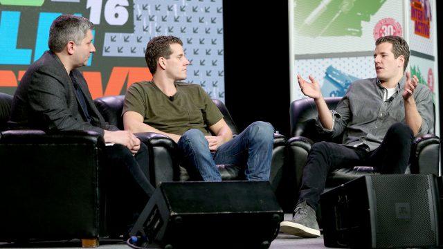 L-R) John Biggs of TechCrunch, Cameron Winklevoss and Tyler Winklevoss