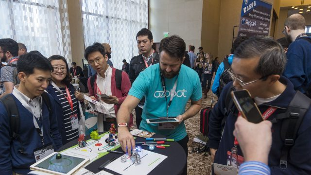 An exhibitor shows his startups product at SXSW 2017
