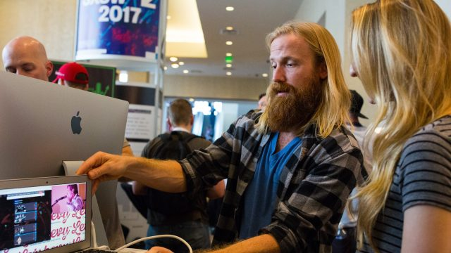 An exhibitor showcases his startups service at SXSW 2017