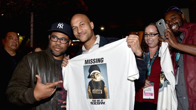 "AUSTIN, TX - MARCH 12:  Actors Jordan Peele (L) and Keegan-Michael Key pass out t-shirts to fans waiting in line for the screening of ""Keanu"" during the 2016 SXSW Music, Film + Interactive Festival at Paramount Theatre on March 12, 2016 in Austin, Texas.  (Photo by Mike Windle/Getty Images for SXSW) *** Local Caption *** Jordan Peele; Keegan-Michael Key"