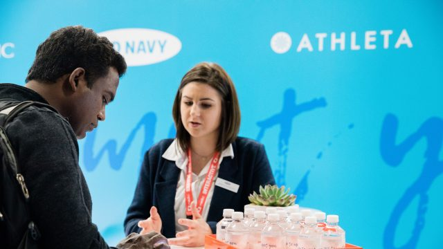 A SXSW attendee talks to an employer at the SXSW Job Market 2017.