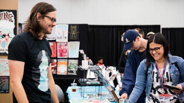 SXSW attendees shop an artist
