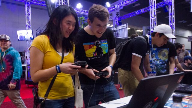 Two SXSW Gaming Expo attendees try out a game at the Student Showcase