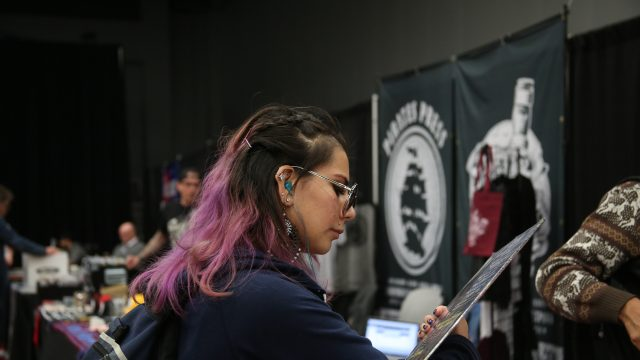 A SXSW attendee checks out some vinyl at Flatstock 59.