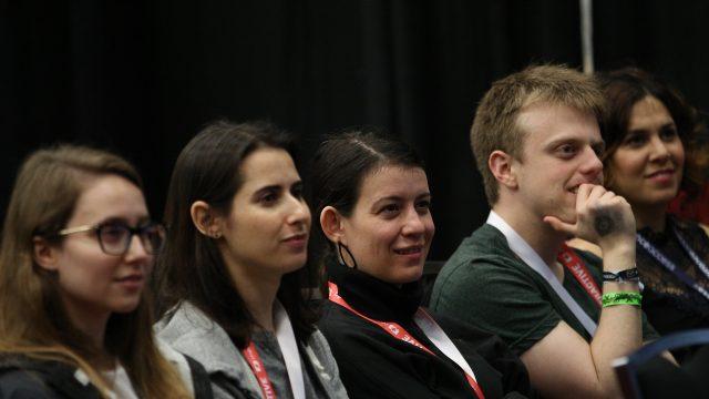 SXSW attendees listen to programming on the SXSW Job Market Stage.