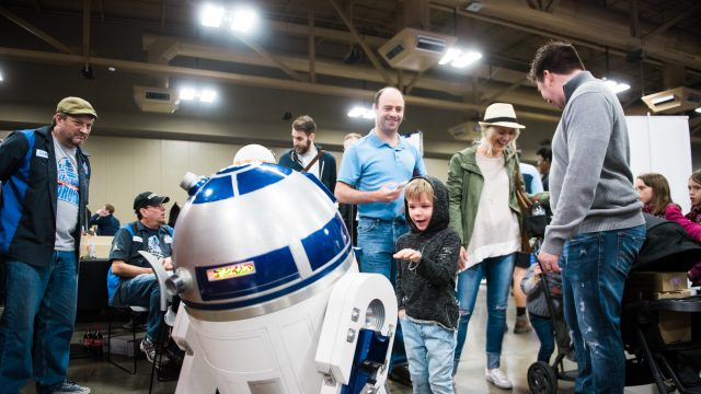 A kid interacts with a droid at SXSW Create in 2017