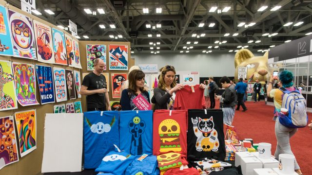 People browsing poster art at Flatstock 59 at SXSW 2017.
