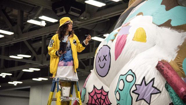 An artist paints at SXSW Marketplace