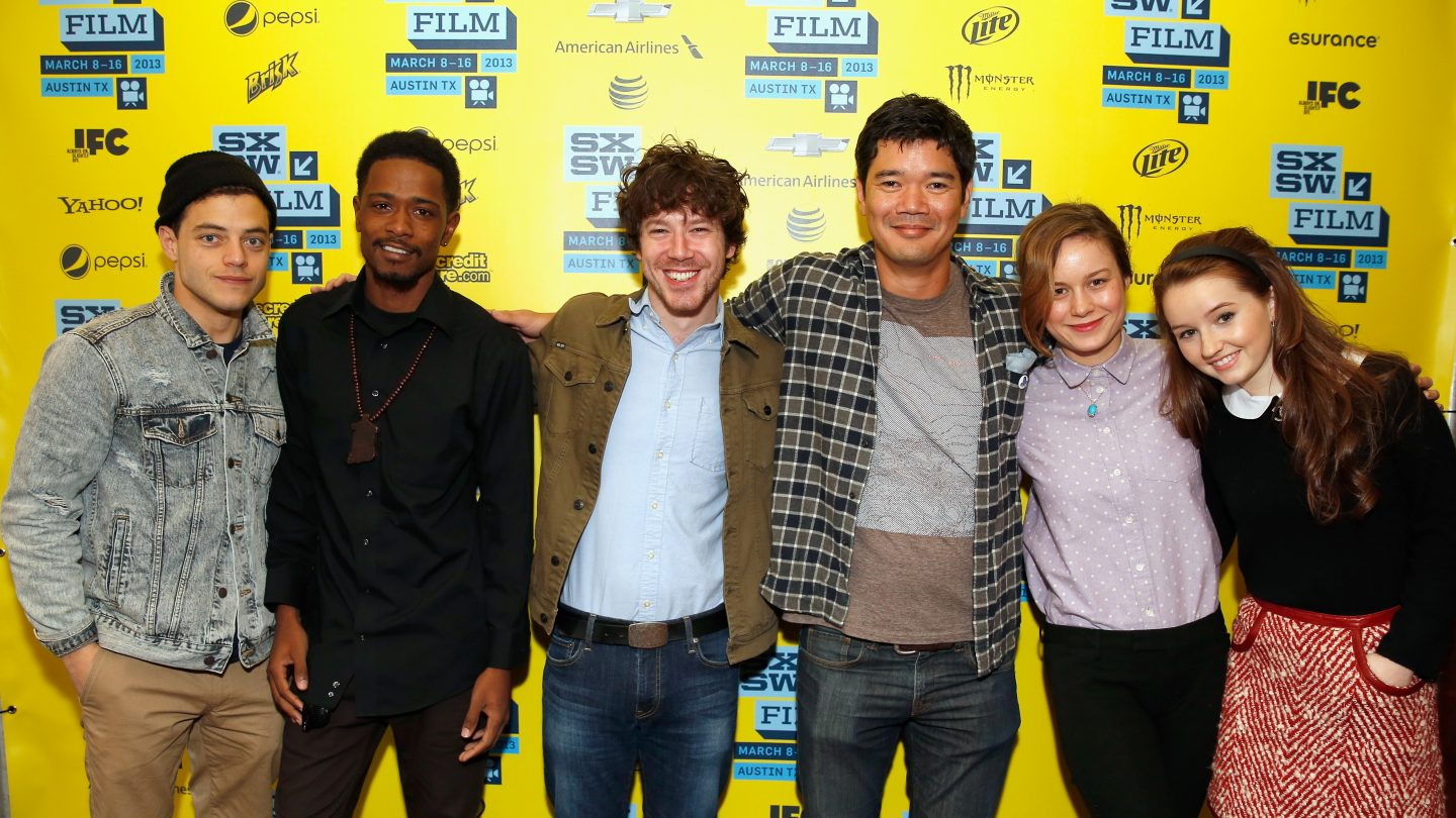 AUSTIN, TX - MARCH 10: (L-R) Actors Rami Malek, Keith Stanfield, John Gallagher Jr., writer/director Destin Cretton and actresses Brie Larson and Kaitlyn Dever pose in the greenroom at the screening of