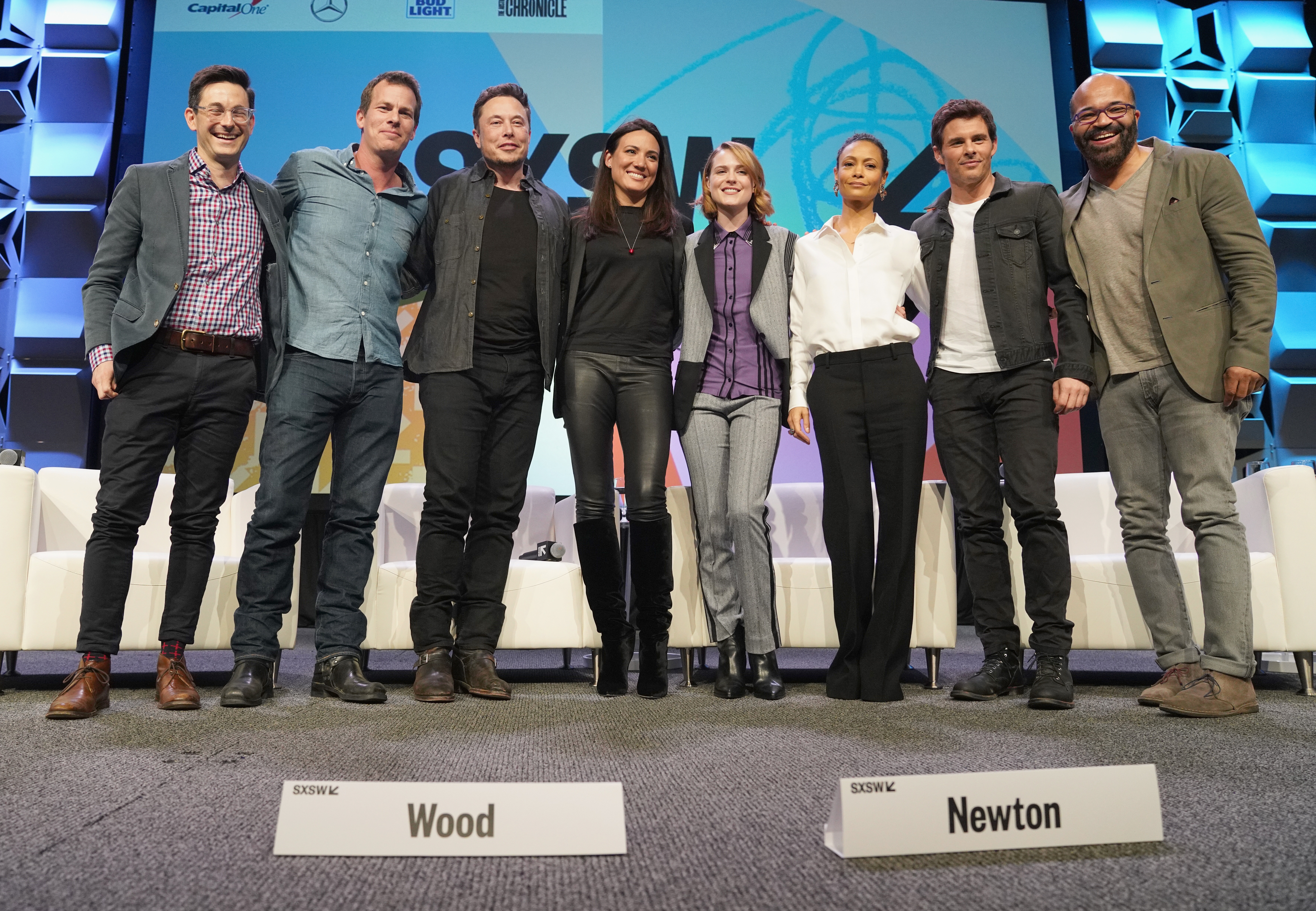 : (L-R) Jason Tanz and showrunner/creator Jonathan Nolan, CEO of SpaceX Elon Musk, showrunner/creator Lisa Joy, actors Evan Rachel Wood, Thandie Newton, James Marsden and Jeffrey Wright speak onstage at the Featured Session during SXSW at Austin Convention Center on March 10, 2018 in Austin, Texas. (Photo by Amy E. Price/Getty Images for SXSW)