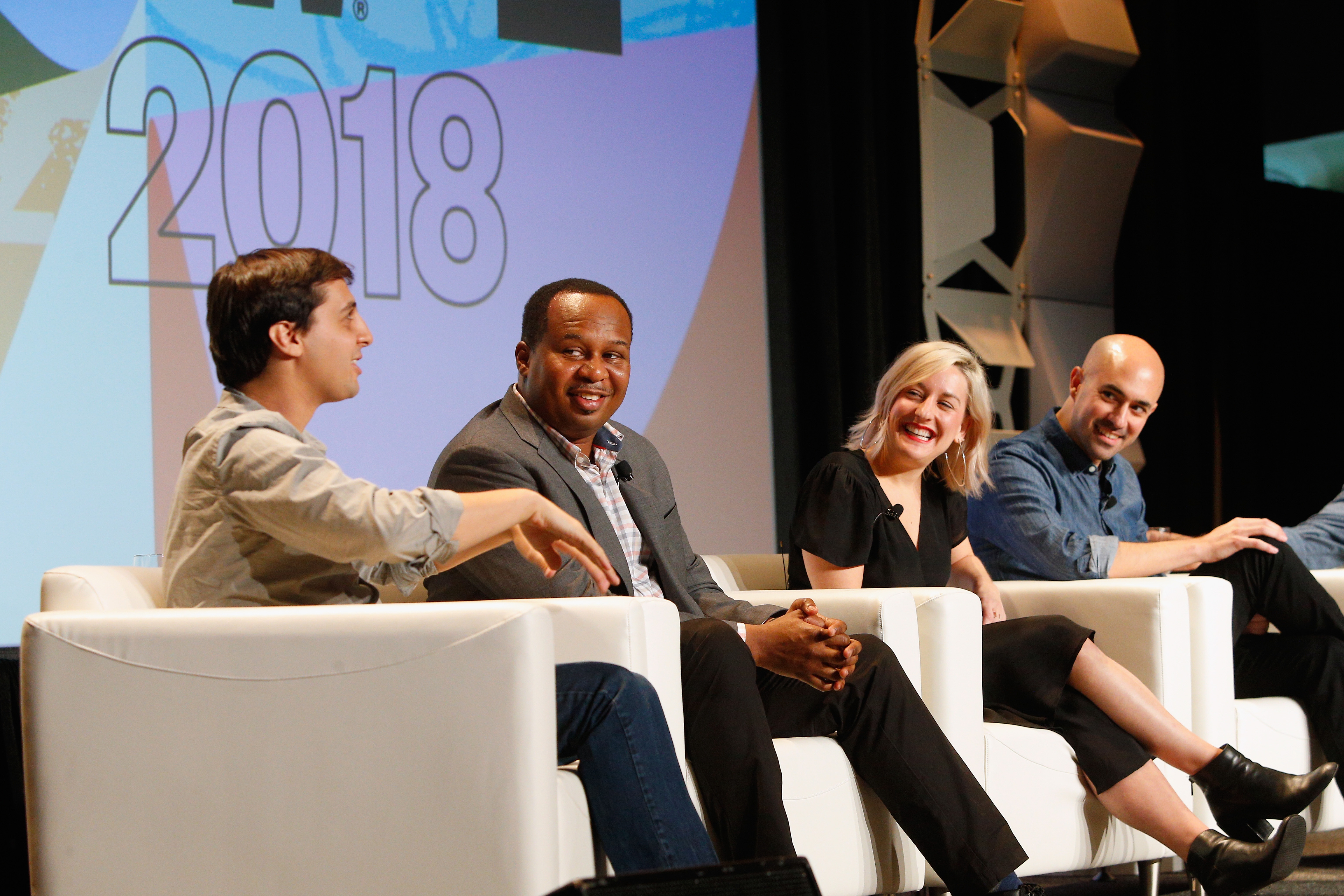 (L-R) Matt Negrin, Roy Wood Jr., Jocelyn Conn and Ramin Hedayati speak onstage at Real Fake News Never Stops: Convo with The Daily Show during SXSW at Austin Convention Center on March 10, 2018 in Austin, Texas. (Photo by Steve Rogers Photography/Getty Images for SXSW)