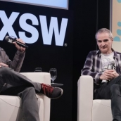 Richard Linklater and Olivier Assayas speak onstage at A Conversation with Olivier Assayas during SXSW at Austin Convention Center on March 11, 2018 in Austin, Texas.  (Photo by Hubert Vestil/Getty Images for SXSW)