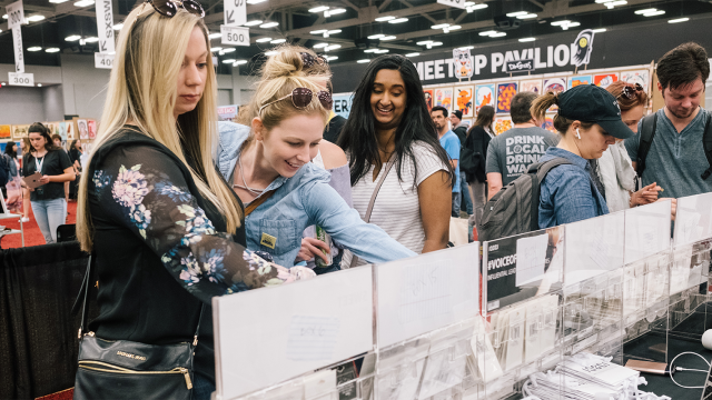 Marketplace attendees browse a local Austin boutique booth