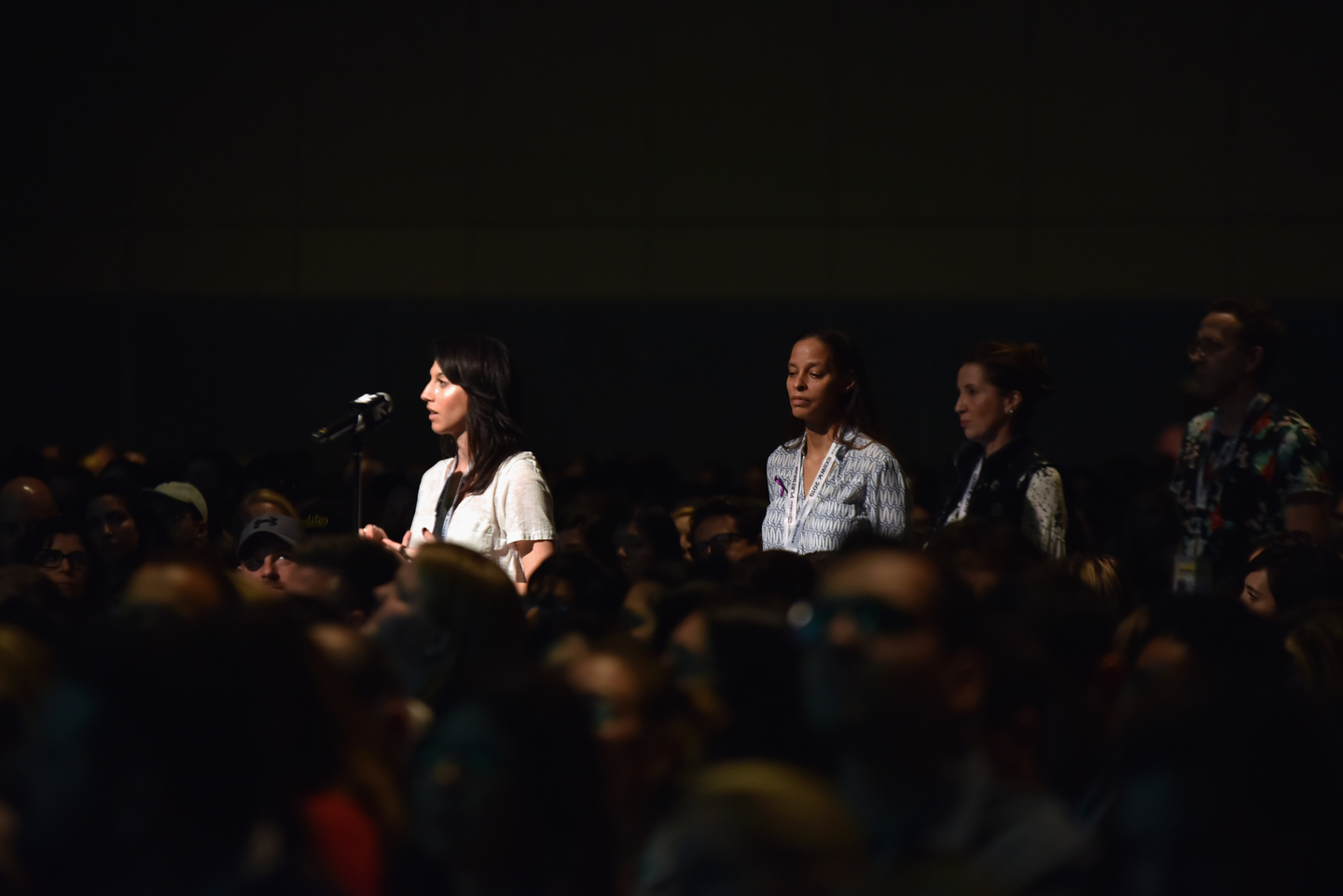 Audience members line up to ask her questions.