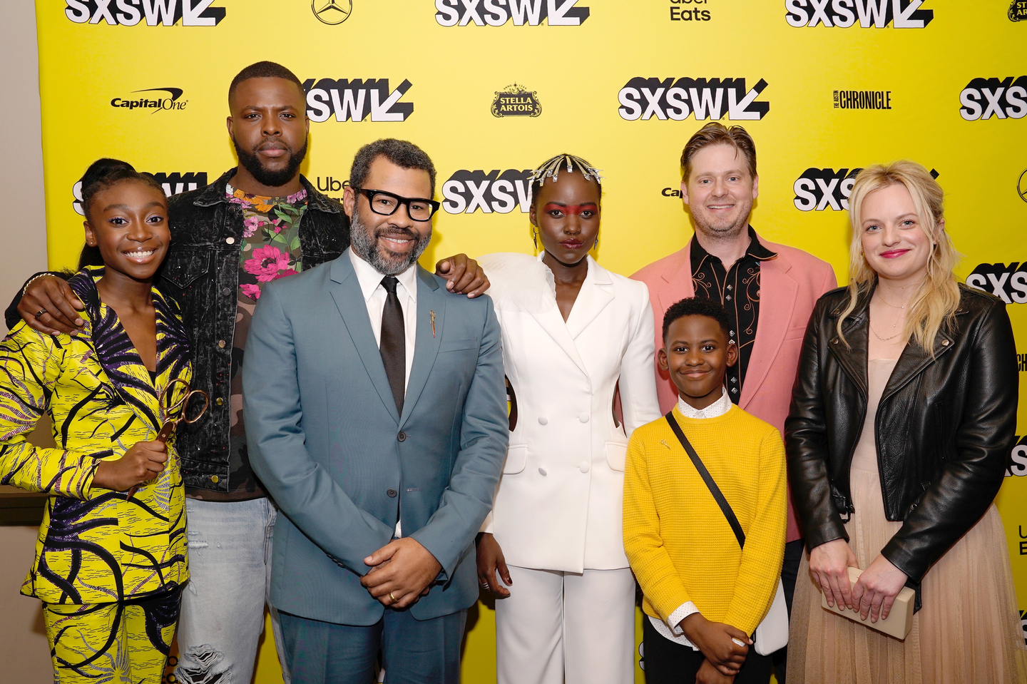 (L-R) Shahadi Wright Joseph, Winston Duke, Jordan Peele, Lupita Nyong'o, Evan Alex, Tim Heidecker, and Elisabeth Moss attend the Us world premiere at the Paramount Theatre - Photo by Ismael Quintanilla/Getty Images for SXSW