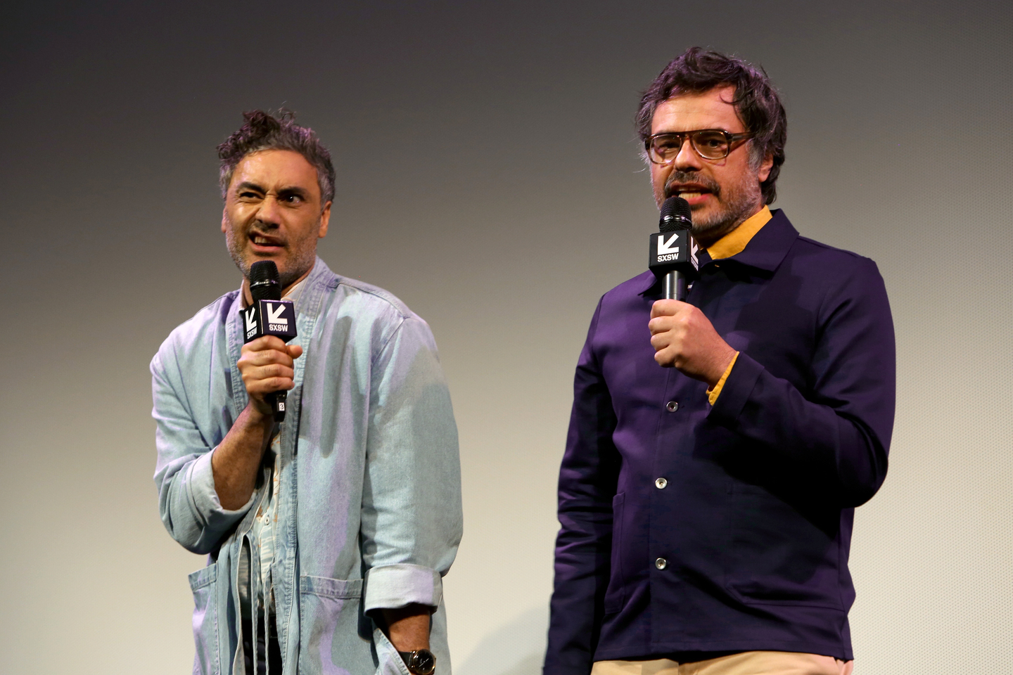 Taika Waititi and Jemaine Clement speak onstage at the What We Do in the Shadows world premiere at the Paramount Theatre. Photo by Travis P Ball/Getty Images for SXSW