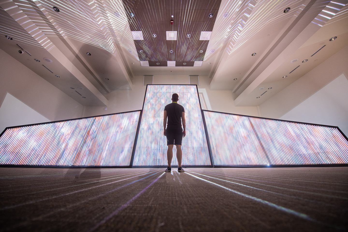 Inspired by the creation of textiles in Mexico through looms, the audiovisual installation uses a large ¨canvas¨ made out of strings of light as a medium of expression. Find it in Room 3 on the first floor of the Austin Convention Center.