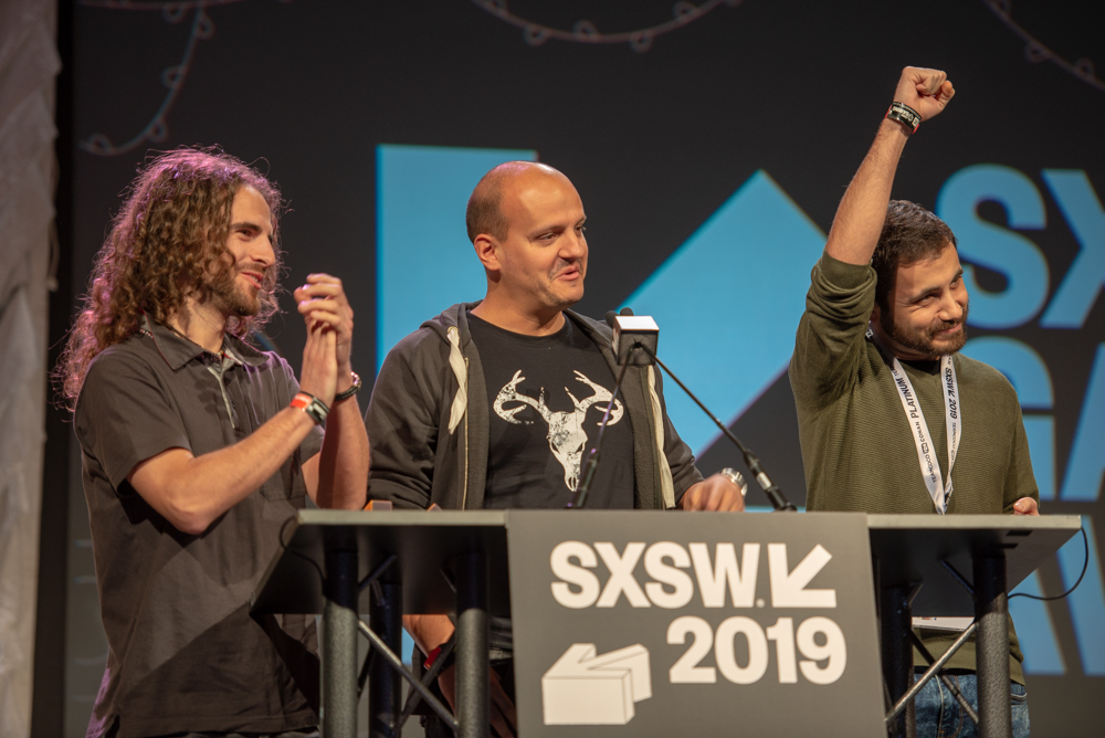 Jose Manuel Camacho, Victor Hernandez & Marcos Neila accept the award for the Gamer's Voice Virtual Reality Game: Intruders: Hide & Seek.