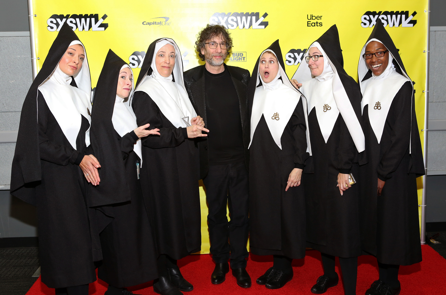 Neil Gaiman (C) with Good Omens' Chattering Order of St. Beryl.