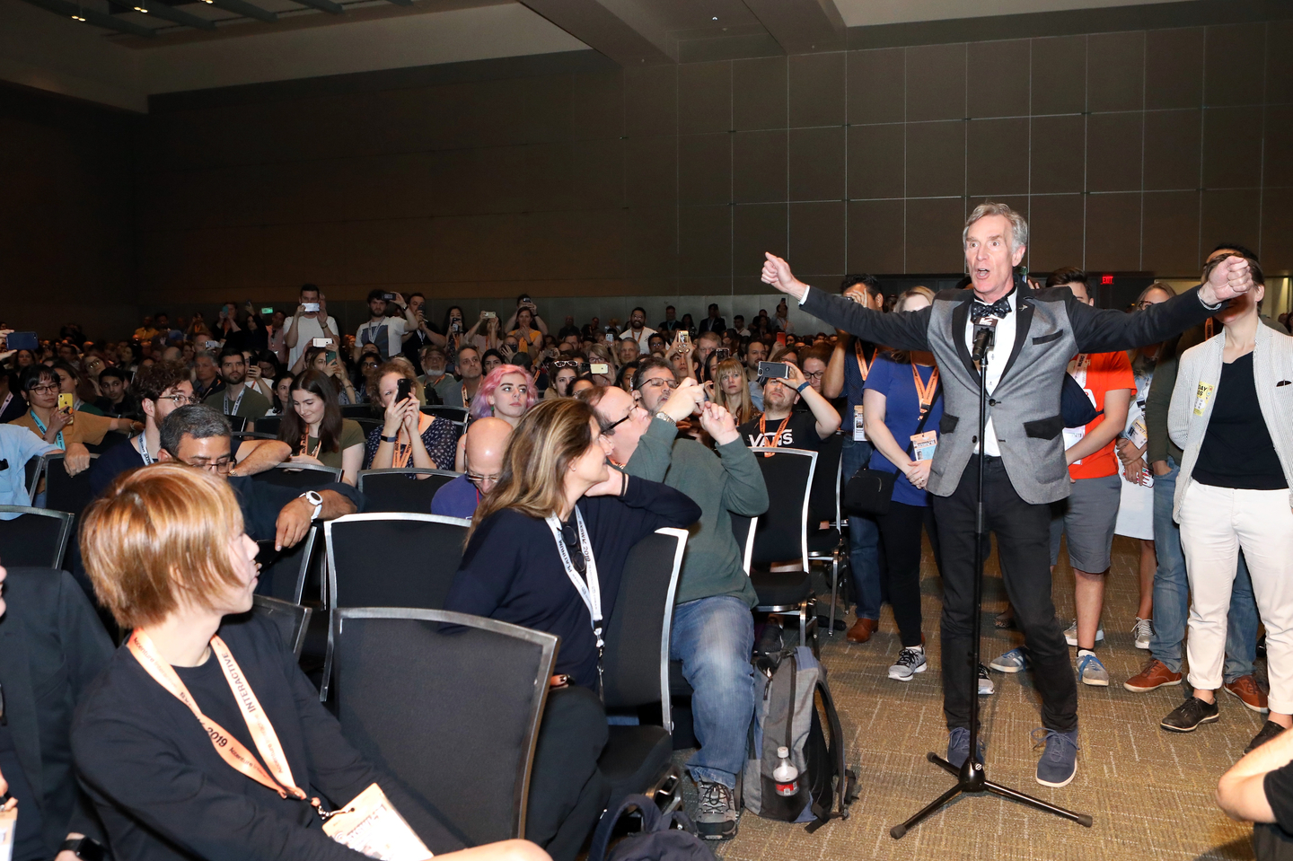 Bill Nye asks Alexandria Ocasio-Cortez a question from the audience. Photo by Samantha Burkardt/Getty Images for SXSW
