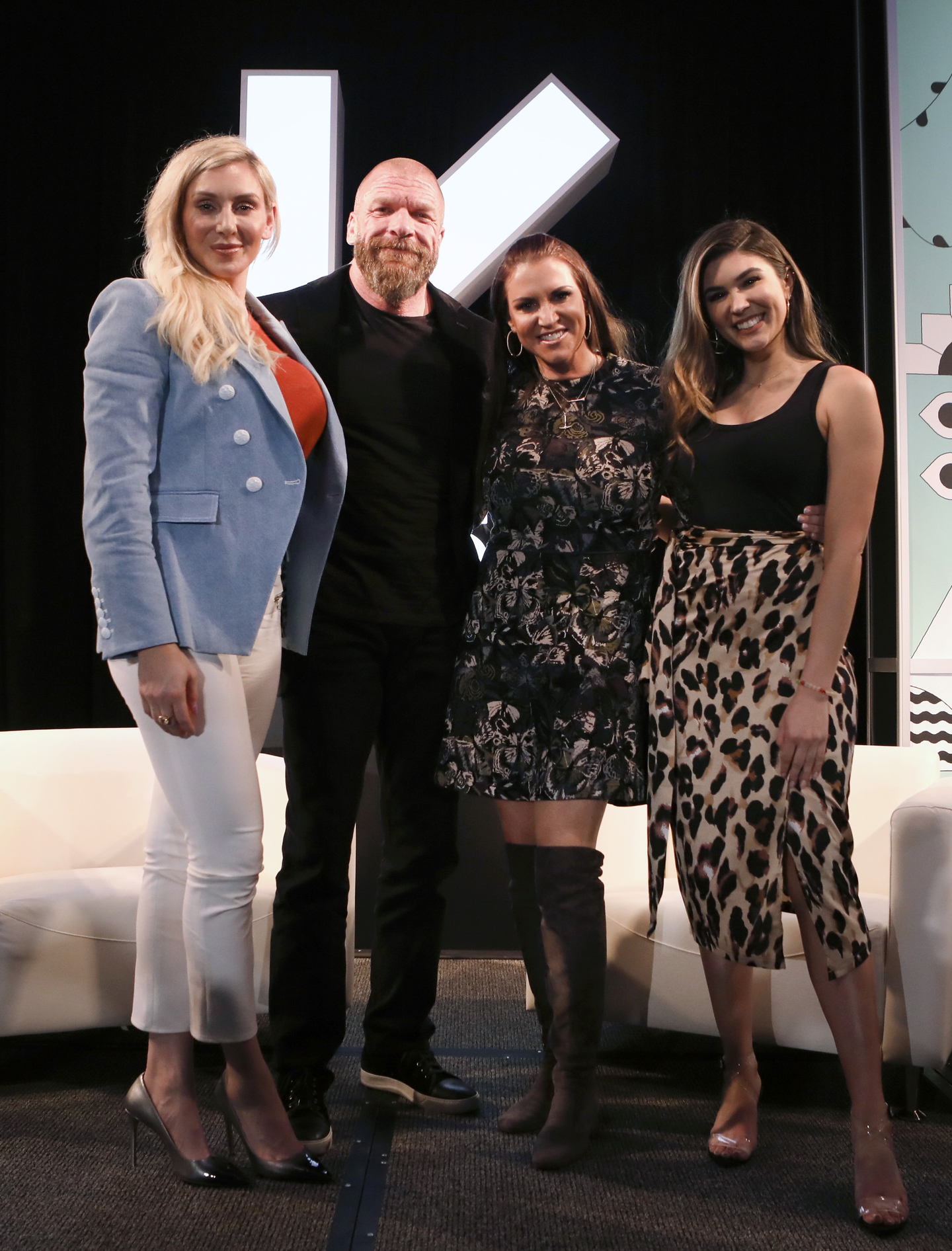 (L-R) Charlotte Flair, Paul Michael Levesque aka 'Triple H', Stephanie McMahon, and Cathy Kelley pose onstage at Featured Session: The Women's Evolution in WWE and Beyond. Photo by Samantha Burkardt/Getty Images for SXSW