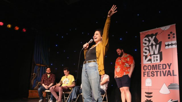 (L-R) Horatio Sanz, Matt Besser, Ilana Glazer, and Jon Gabrus speak onstage at Upright Citizens Brigade's ASSSSCAT at Esther's Follies.