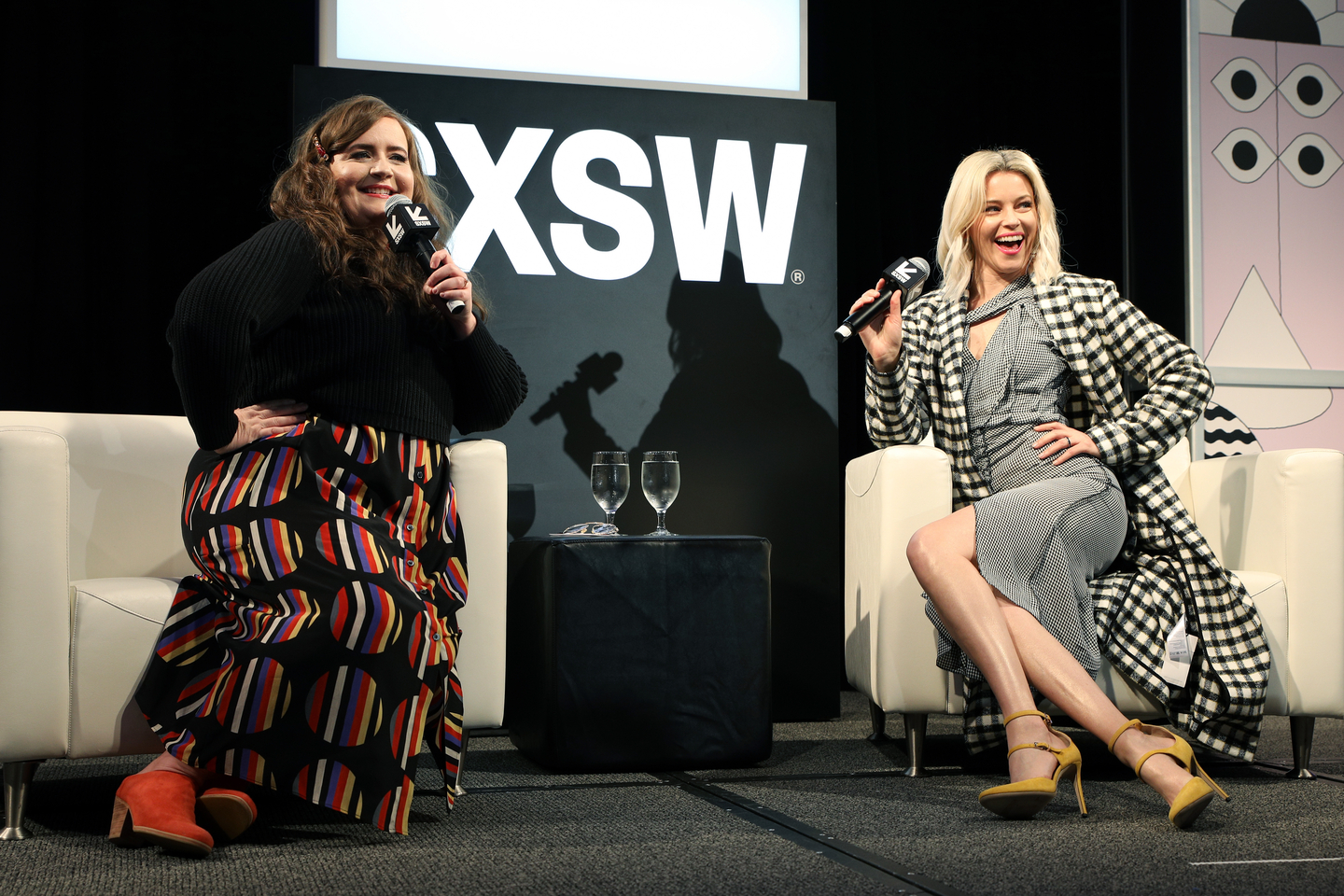 (L-R) Aidy Bryant and Elizabeth Banks speak onstage at their Featured Session: Elizabeth Banks with Aidy Bryant, talking about their new show Shrill. Photo by Mike Jordan/Getty Images for SXSW