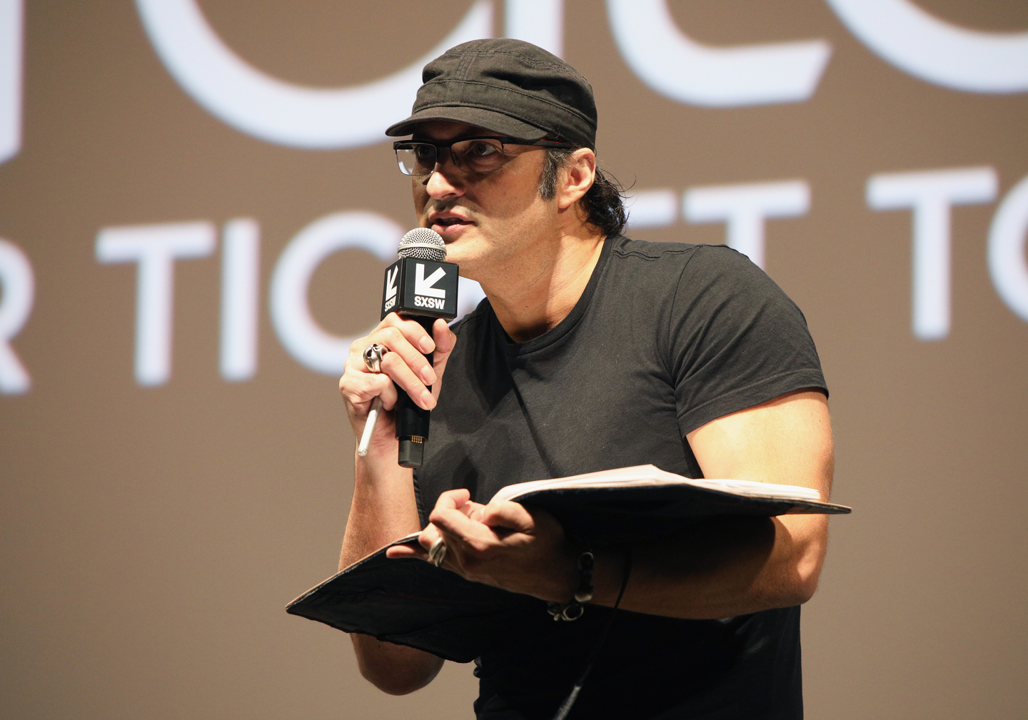 Robert Rodriguez speaks onstage at The Robert Rodriguez Film School and Red 11 premiere at Atom Theater.