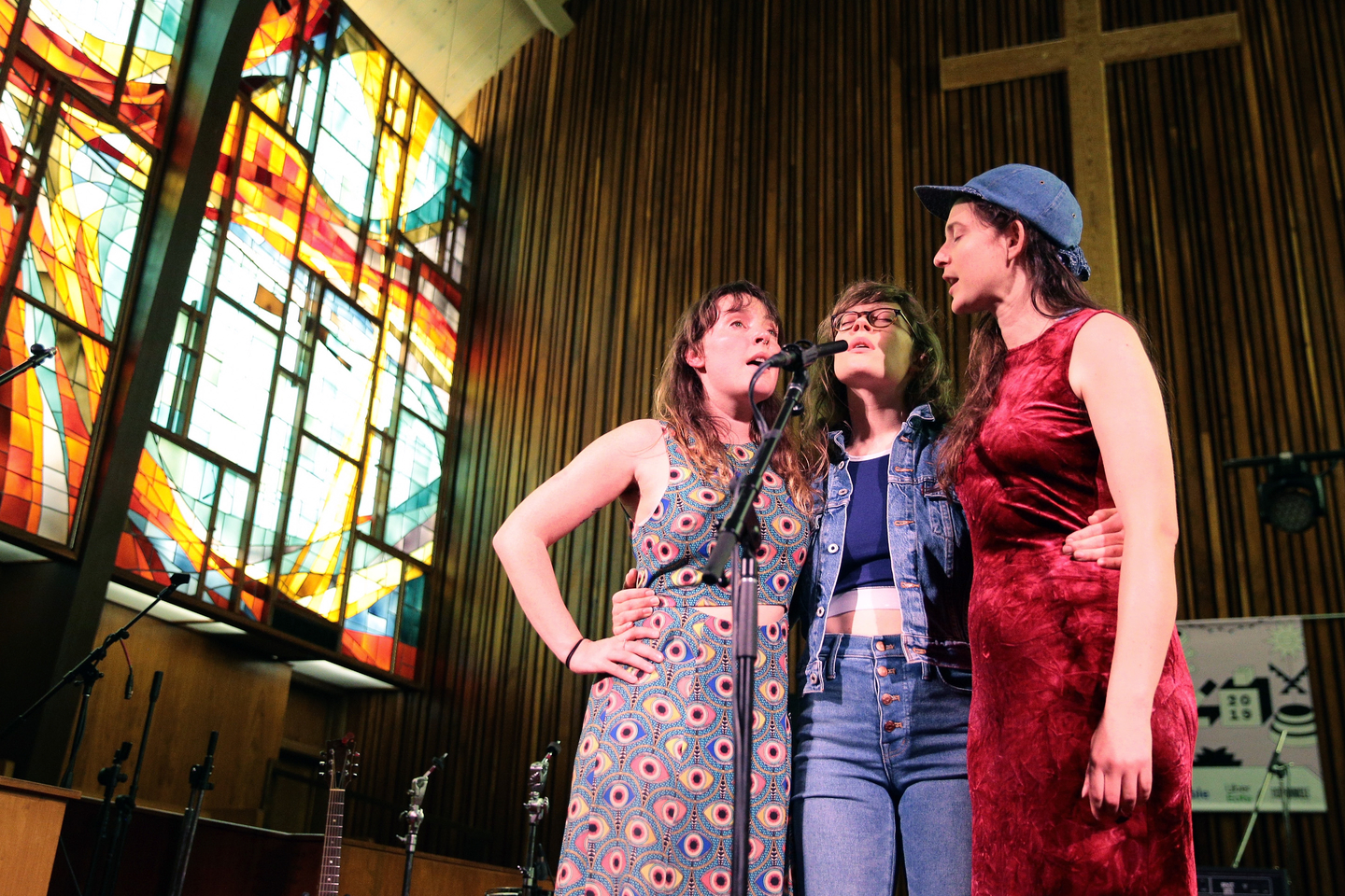 (L-R) Amelia Meath, Alexandra Sauser-Monnig, and Molly Erin Sarle of Mountain Man perform onstage at NPR Tiny Desk Concert at Central Presbyterian Church.