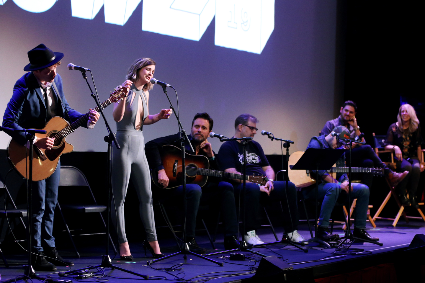 (L-R) Justin Davis and Sarah Zimmermann of Striking Matches, Charles Esten, Barry Dean, Luke Laird, Brian LoSchiavo, and Erika Wollam Nichols perform onstage at the Bluebird premiere the Paramount Theater.