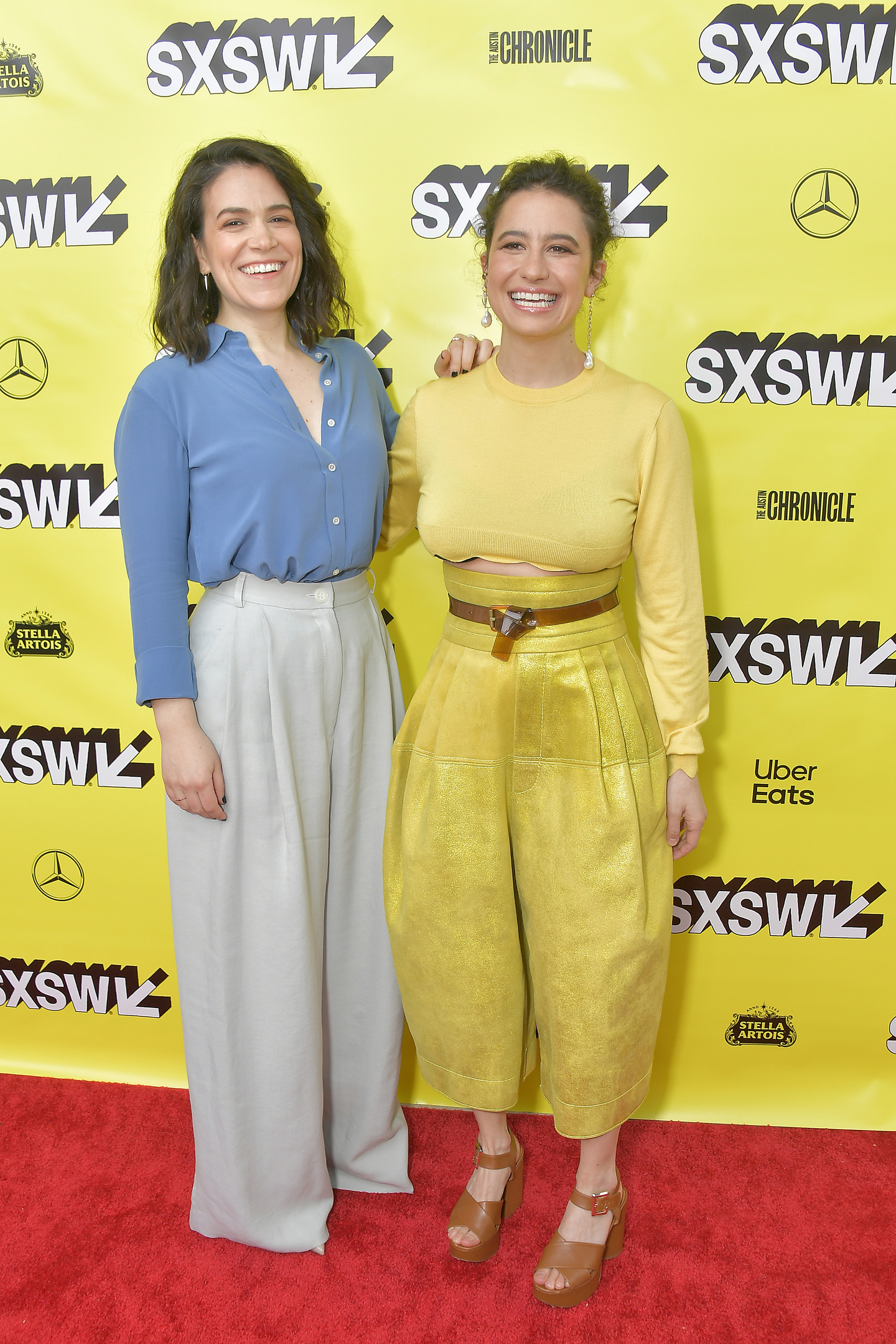 Actresses Ilana Glazer (L) and Abbi Jacobson attend the premiere of the Broad City series finale at the ZACH Theatre.