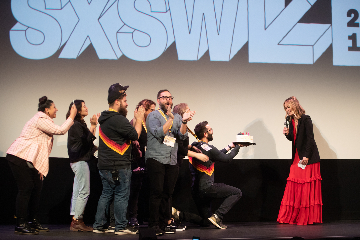The SXSW Film Staff present Olivia Wilde with a birthday cake while she attends the Booksmart Premiere at the Paramount Theatre.