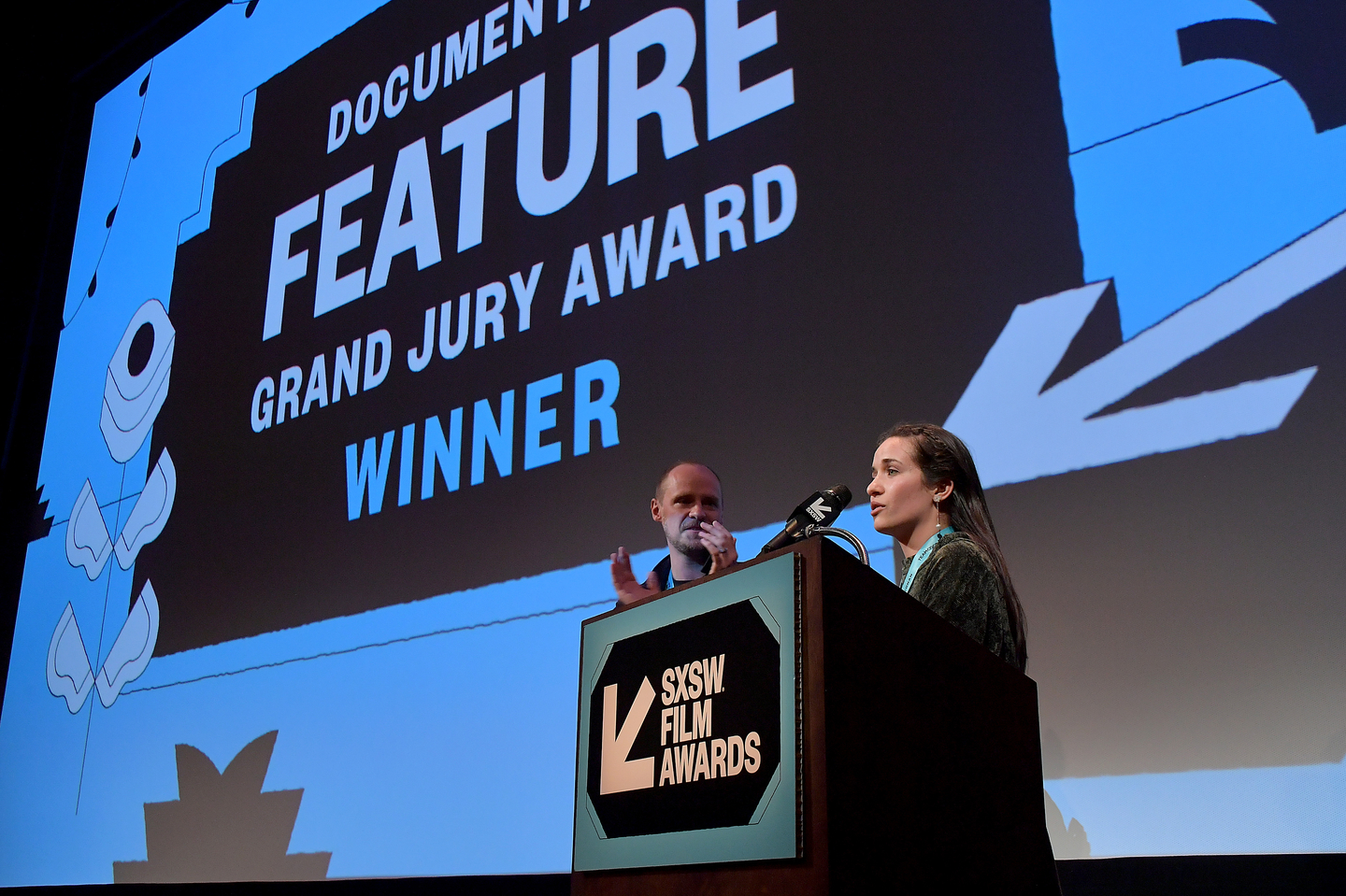 Edward Watts and Waad al-Kateab accept the Documentary Feature Grand Jury Award for their film For Sama at the SXSW Film Awards at the Paramount Theatre.