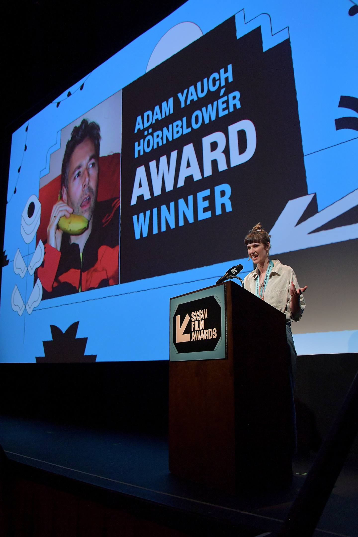 Grace Glowicki accepts the Adam Yauch Hornblower Award for her film Tito at the SXSW Film Awards at the Paramount Theatre.