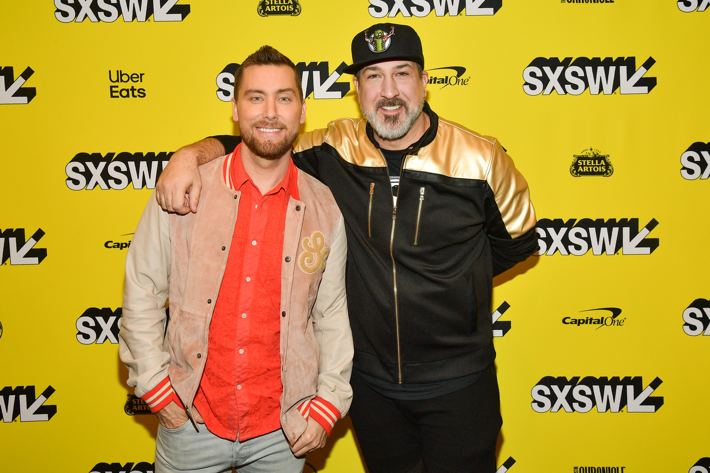 Lance Bass and Joey Fatone attend the premiere of The Boy Band Con: The Lou Pearlman Story at the Paramount Theatre.