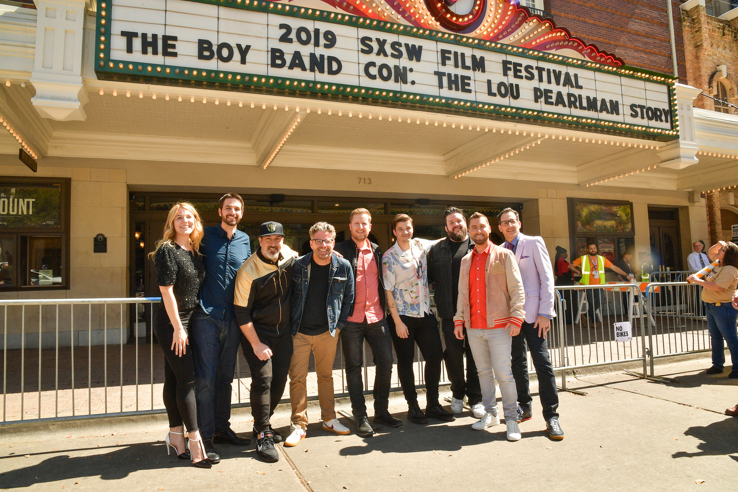 Callie Foster, Shane Patterson, Joey Fatone, Dave Holmes, Aaron Kunkel, Matthew Charles Ducey, Henry Darrow McComas, Lance Bass, and Nicholas Caprio attend the The Boy Band Con: The Lou Pearlman Story premiere at the Paramount Theatre.