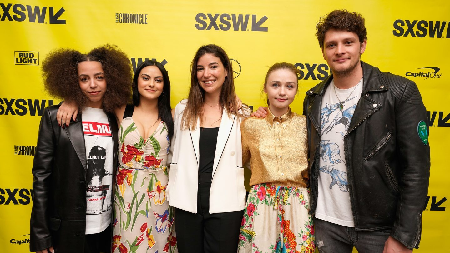 Carly Stone (center) and actors attend the premiere of The New Romantic. Photo by Ismael Quintanilla/Getty Images for SXSW.