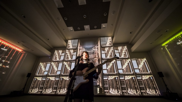 Stella Donnelly performs for NPR's SXSW Lullabys in front of the Conductors and Resistance installation by Ronen Sharabani, part of the SXSW Art Program, is on display through Saturday in Room 3 at the Austin Convention Center.