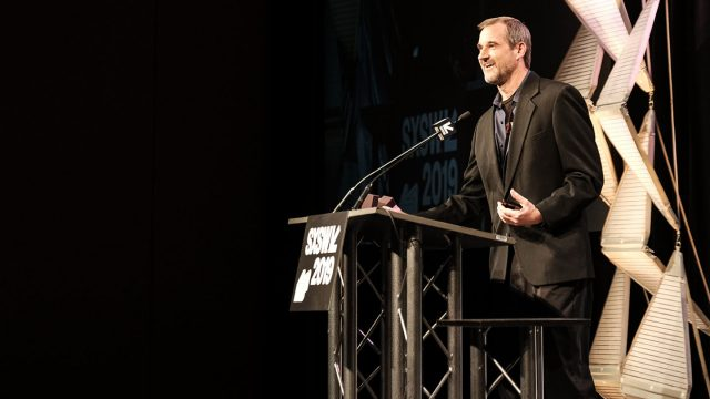 Ken Roy accepting an award for God of War at the 2019 SXSW Gaming Awards Ceremony.