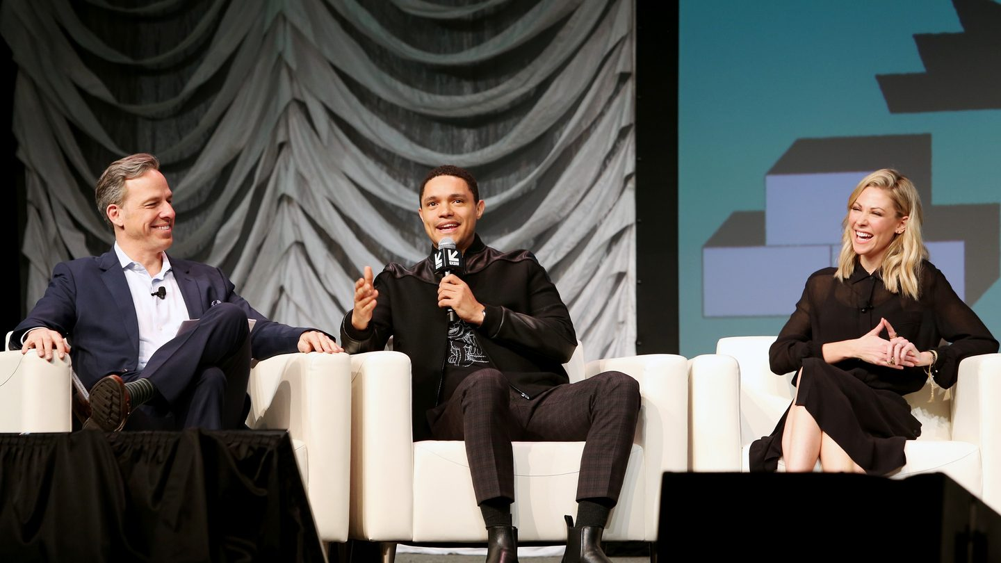 (L-R) Jake Tapper, Trevor Noah, and Desi Lydic speak onstage at Featured Session: The Daily Show with Trevor Noah. Photo by Travis P Ball/Getty Images for SXSW