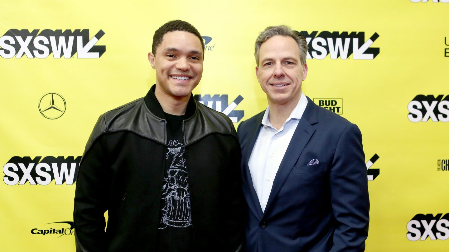 Trevor Noah and Jake Tapper at The Daily Show with Trevor Noah Featured Session – Photo by Travis P Ball/Getty Images for SXSW