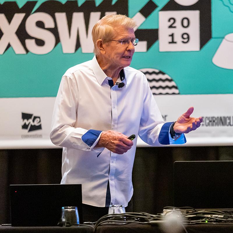 83 Year Old Triathlete Talks Corporate Culture - 2019 - Photo by John Feinberg