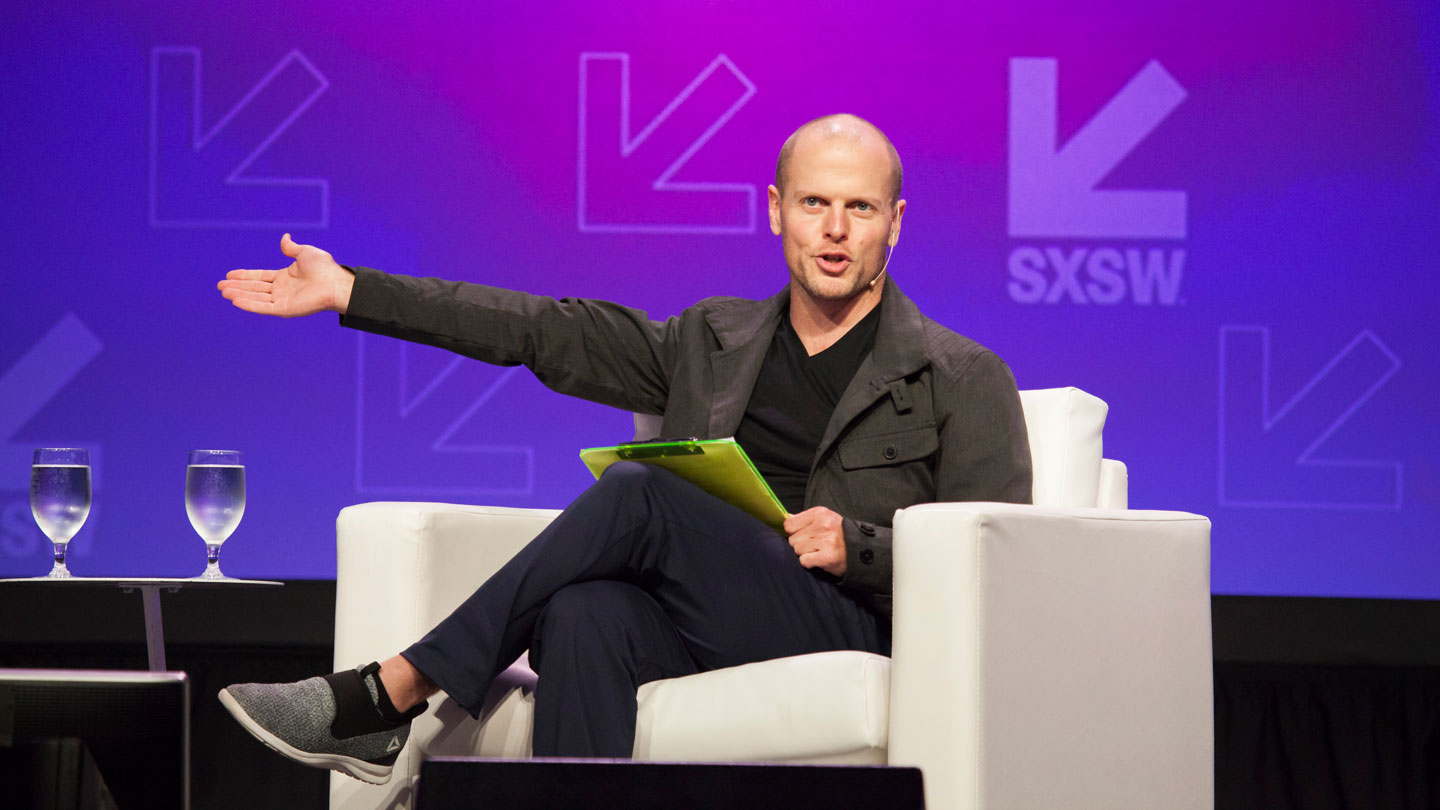 Tim Ferriss speaks onstage at 'The Tim Ferriss Show LIVE with Cheryl Strayed' - SXSW 2017. Photo by Samantha Burkardt