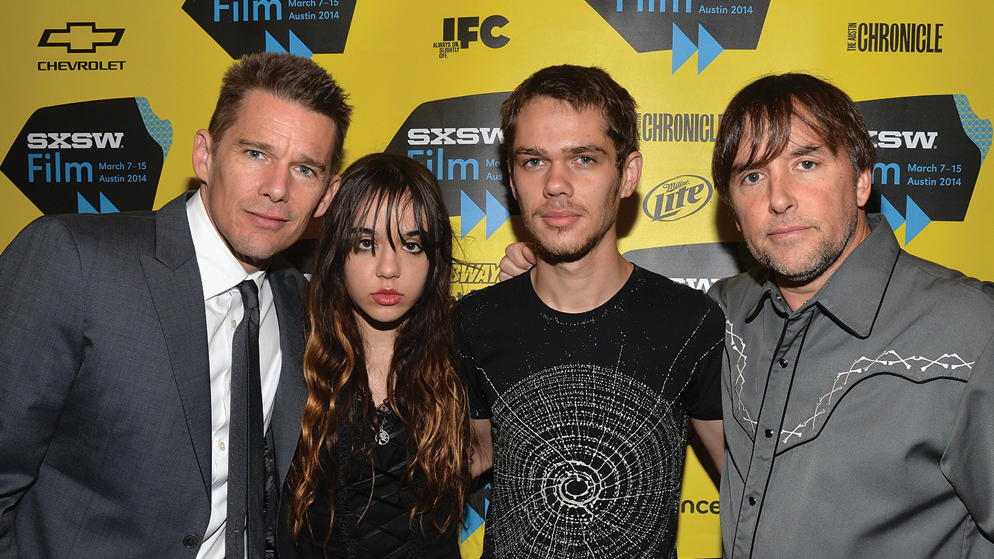 Actor Ethan Hawke, actress Lorelei Linklater, actor Ellar Coltrane and director Richard Linklater arrive at the premiere of