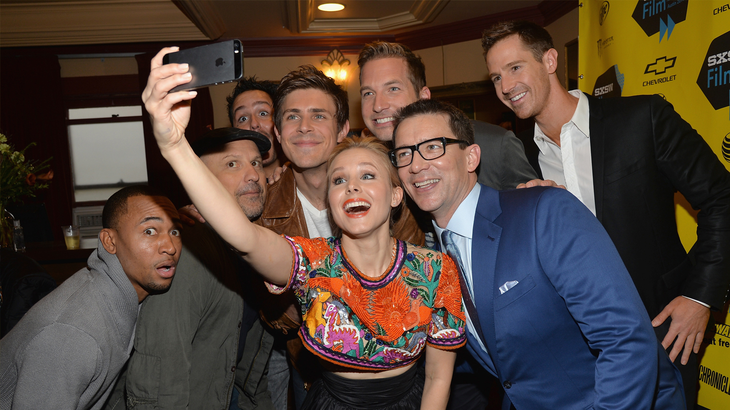 Actress Kristen Bell (C) poses for a selfie with cast members (L-R) Percy Daggs, Enrico Colantoni, Chris Lowell, Ryan Hansen, Jason Dohring and director Rob Thomas at the premiere of