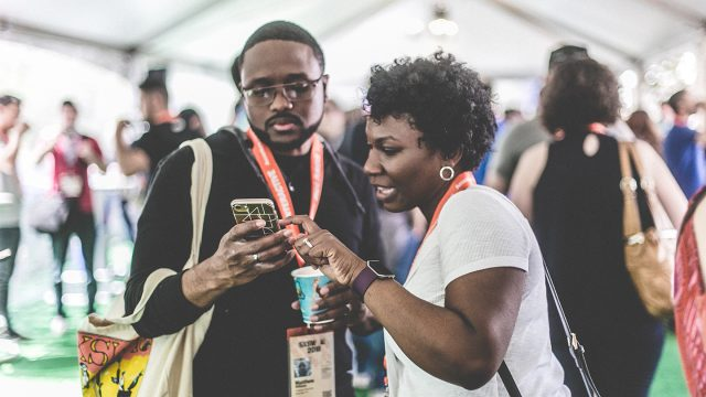 Attendees checking phone at the Registrants Lounge during SXSW 2018. Photo by Dylan Johnson.
