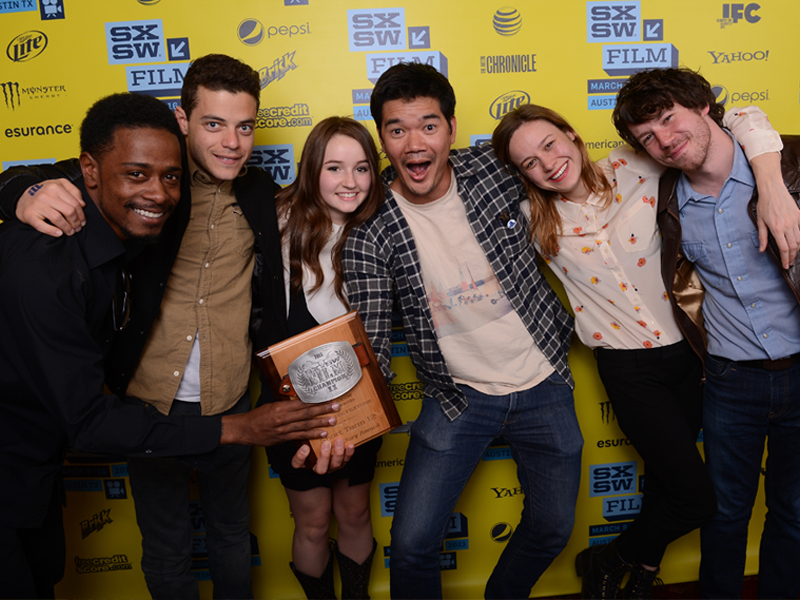 Actors Keith Stanfield, Rami Malek, Kaitlyn Dever, writer/director Destin Cretton of the film Short Term 12, and actors Brie Larson and John Gallagher Jr. pose with their Grand Jury Award for Narrative Feature at the 2013 SXSW Film Awards. Photo by Michael Buckner/Getty Images for SXSW.